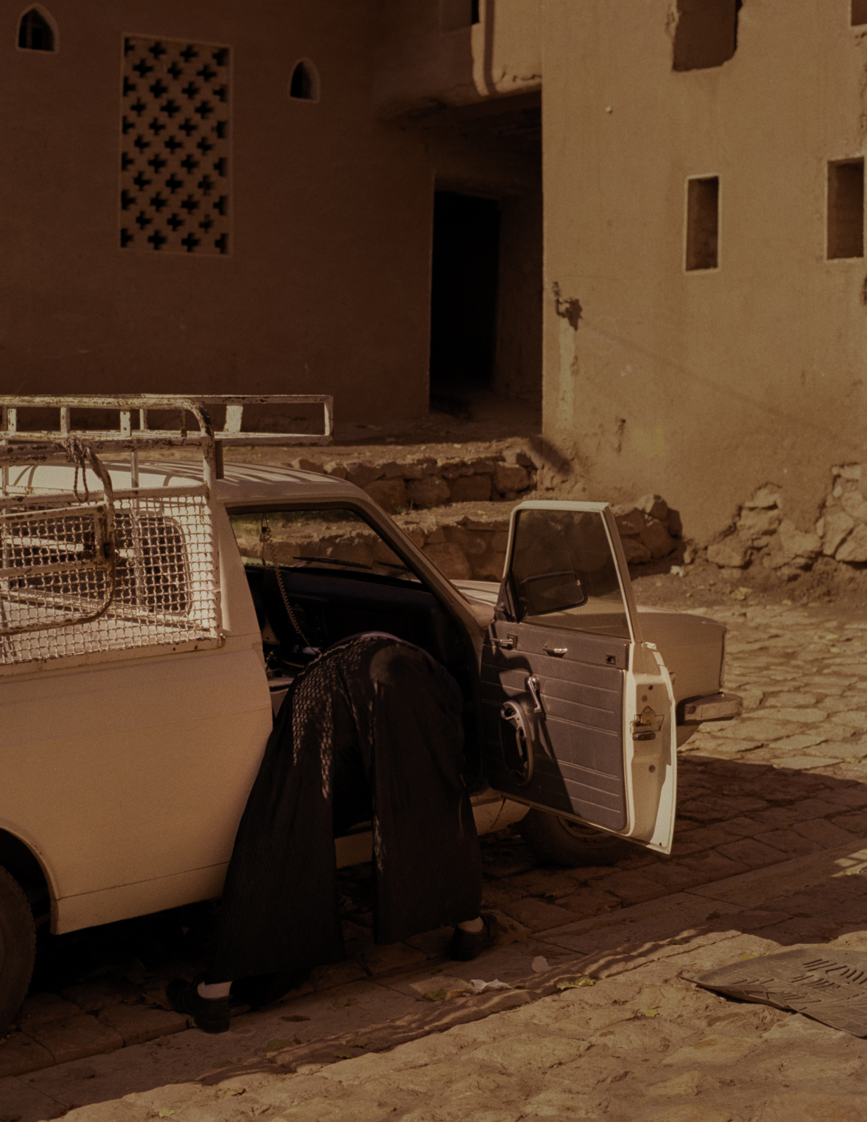 Man cleaning his car in Abyaneh, Iran