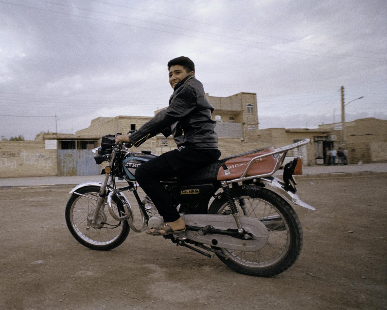 Boy on bike, Iran